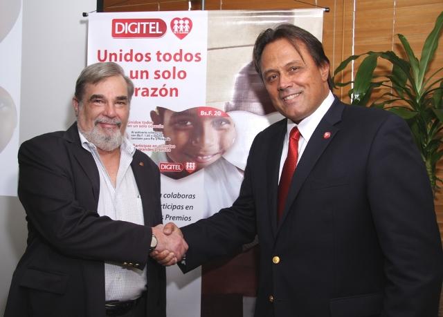 Charles Lazzari de Fe y Alegría y Juan Carlos Sánchez, VP de Mercadeo de Digitel